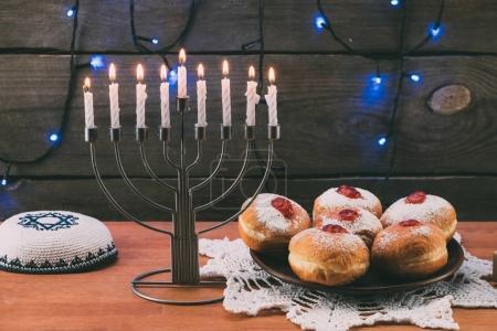 menorah, Kippah and donuts for hanukkah