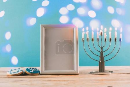 frame, menorah and cookies for hanukkah