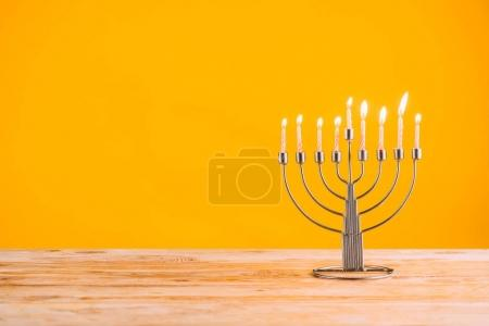 hanukkah celebrating with menorah