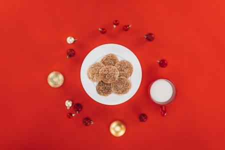 oatmeal cookies, milk and christmas balls