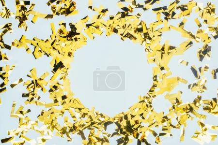 frame made of golden confetti