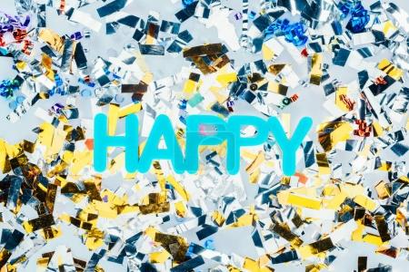 Photo for Top view of happy sign with colorful confetti - Royalty Free Image
