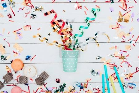 paper cup with confetti