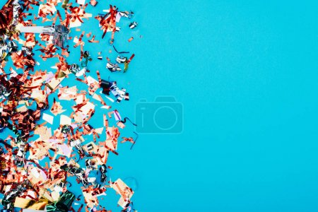 Photo for Top view of frame made of confetti isolated on blue - Royalty Free Image