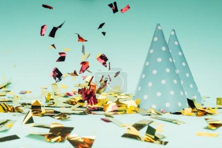 Photo for Beautiful glossy falling confetti with party hats - Royalty Free Image