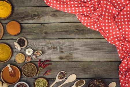 red tablecloth and different spices