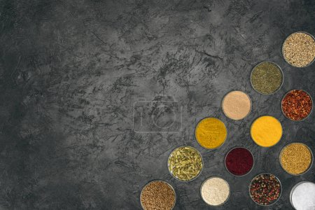 Different spices in glass bowls