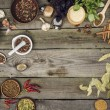 Top view of different spices and herbs on a gray w...