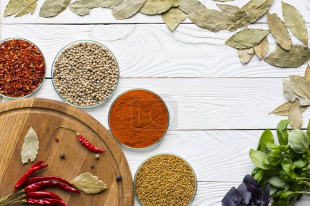 Bay leaves and bowls with spices