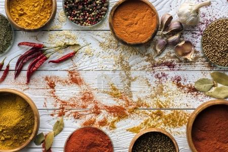 scattered spices and glasses with spices