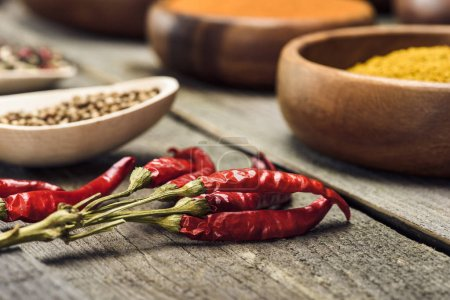 Photo for Chili peppers on a wooden gray table - Royalty Free Image