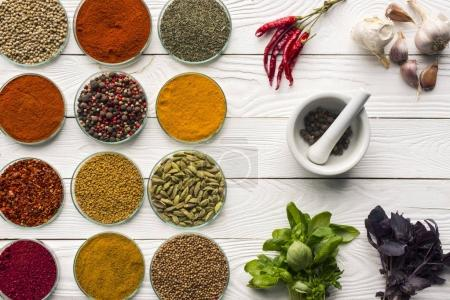 bowls with spices and mortar with pestle