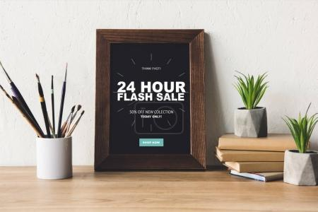 photo frame and book on tabletop