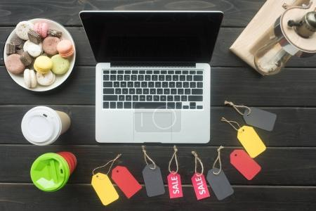 laptop and sale tags
