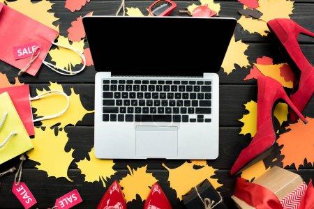 laptop on paper foliage