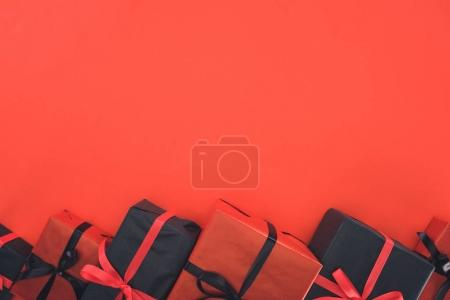 Photo for Top view of presents and gift boxes, isolated on red with copy space - Royalty Free Image