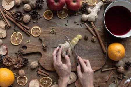 woman cutting ginger