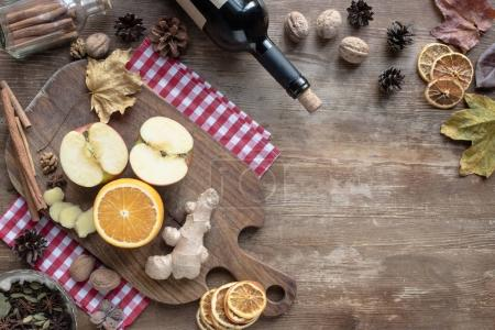 fruits and ginger on wooden board