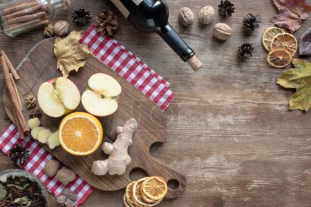Photo for Top view of fruits and ginger on a wooden board - Royalty Free Image