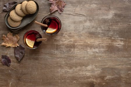 glasses with mulled wine and cookies