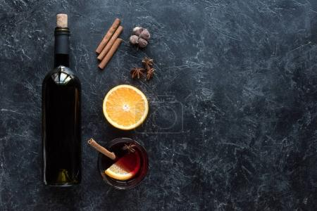wine bottle and glass with mulled wine