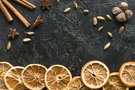 dried oranges with seeds and carnation