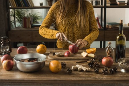 woman cutting apples for mulled wine