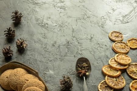 Dried oranges with cookies and pine cones
