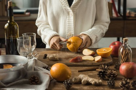 woman cutting fruits