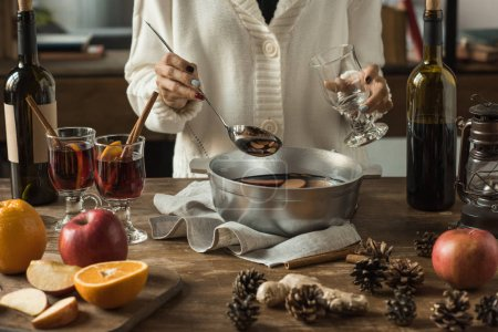 woman pouring homemade mulled wine