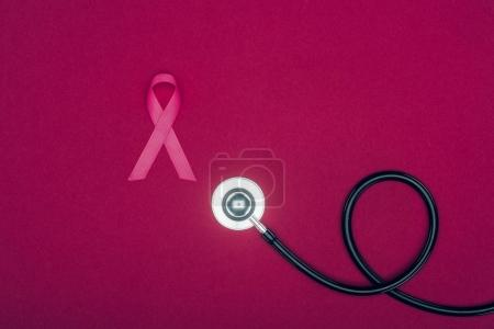stethoscope and breast cancer ribbon