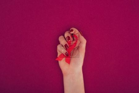 hand with aids ribbon