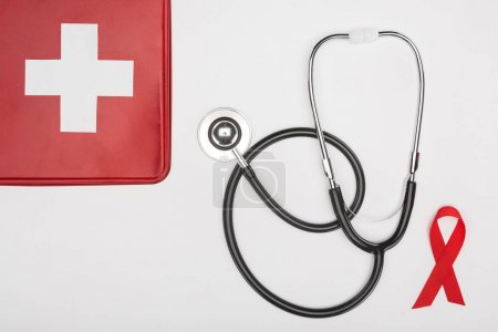 first aid kit, stethoscope and aids ribbon
