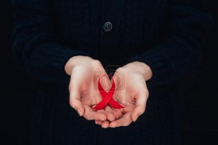 aids ribbon in hands