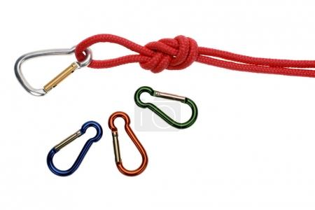 Photo for Close-up view of red rope with loop and carabiners isolated on white - Royalty Free Image