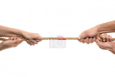 Photo for Cropped shot of people holding rope with red adhesive tape isolated on white - Royalty Free Image