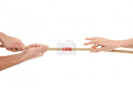 Photo for Close-up partial view of people holding rope with red adhesive tape isolated on white - Royalty Free Image