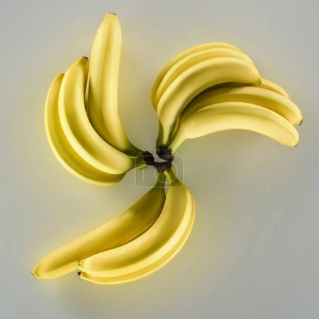 Photo for Close-up view of fresh ripe yellow bananas isolated on grey - Royalty Free Image