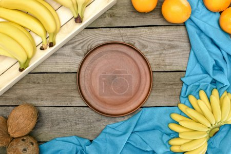 tropical fruits and empty plate
