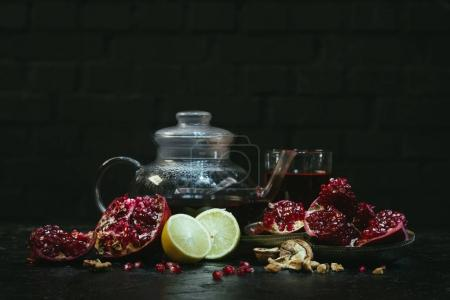 teapot and glass with pomegranate juice