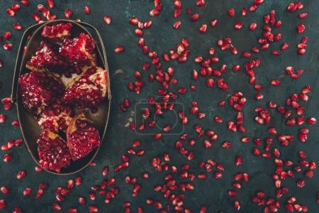 pomegranate pieces in metal bowl