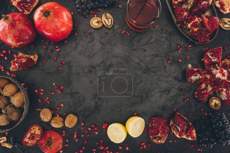 Photo for Top view of pomegranate juice in glass and fruits on a table - Royalty Free Image