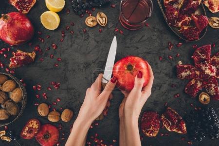 woman peeling pomegranate