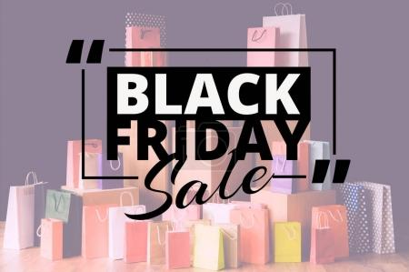 Photo for Many shopping bags and little shopping cart, black friday concept - Royalty Free Image