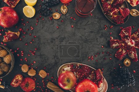 pomegranate juice in glass and fruits