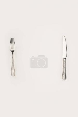 Photo for Top view of fork and knife isolated on grey - Royalty Free Image