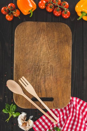 cutting board with utensils and ingrediengs