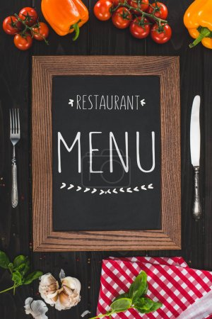 menu, cutlery and vegetables