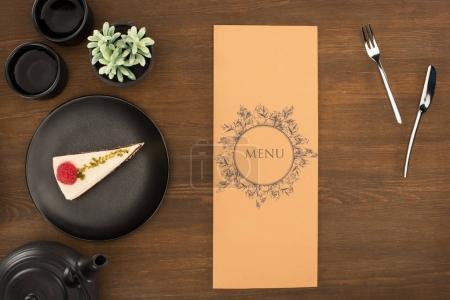 tea set, menu and dessert