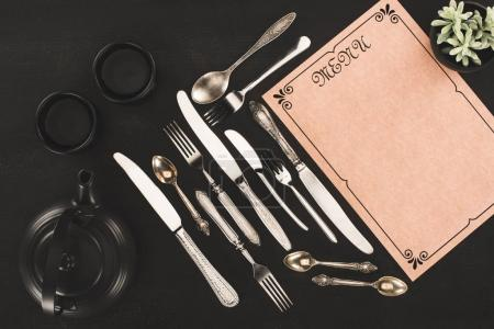 menu, cutlery and tea set